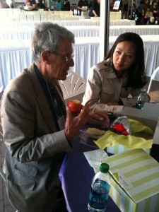 Tom Hall GHEC Executive Director Speaks with Student at CUGH10