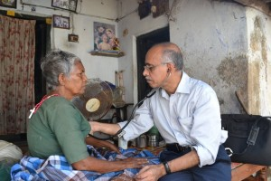 Dr. Raj conducting a home visit, Trivandrum Southern India