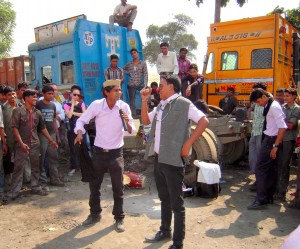 Actors performing skit on STD awareness at truck stop in New Delhi, India.